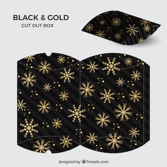 Ausgeschnittene schachtel mit goldenen schneeflocken