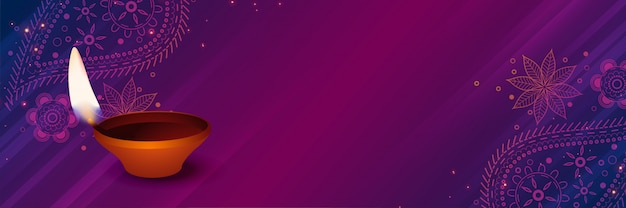 Auspicious diwali diya auf purpurrotem dekorativem hintergrund