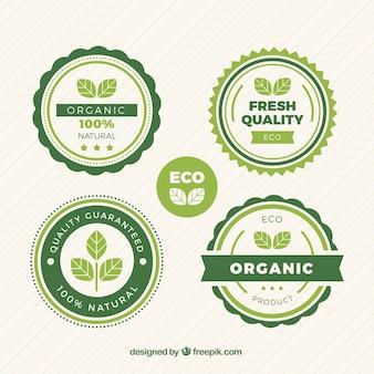 Auswahl von runden etiketten mit grünen blättern