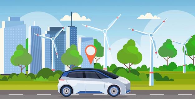 Automobil mit standort pin auf der straße online-bestellung taxi carsharing-konzept mobiltransport carsharing-service windturbinen stadtbild hintergrund flache horizontale banner