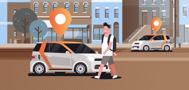 Autos mit standort pin auf der straße online bestellen taxi carsharing konzept mobilen transport mann mit carsharing-service moderne stadtstraße stadtbild