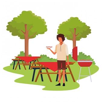 Avatarmann in einem picknick und in einem grill