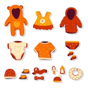Baby-bekleidung, kleidung und accessoires vektor-cartoon-set isoliert auf weißem hintergrund.