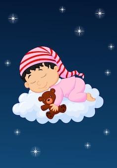 Baby schläft auf der wolke