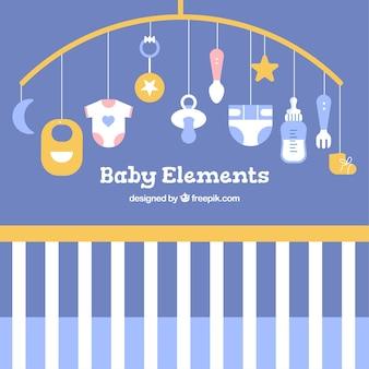 Babyelementhintergrund mit netten spielwaren und kleidung