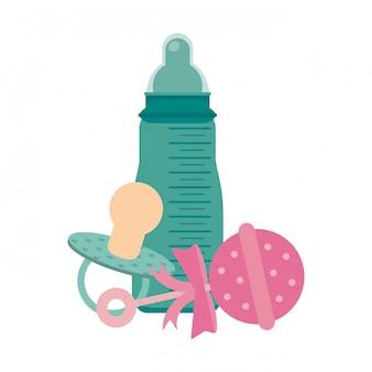 Babyflasche und maraca mit schnuller