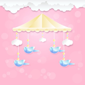 Babymobil mit vogelspielzeug und -wolke auf rosa
