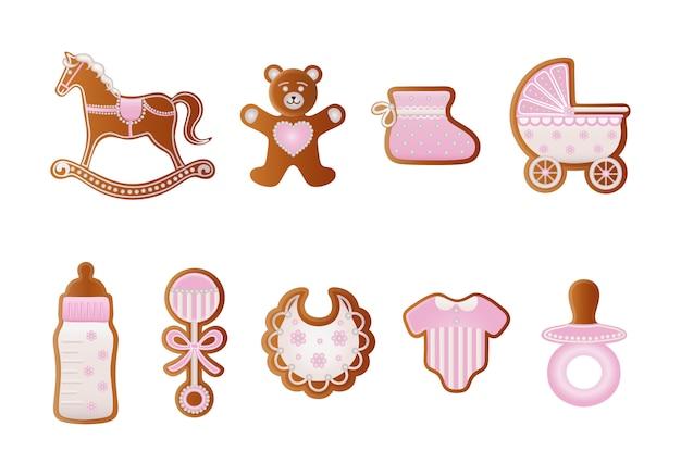 Babyparty-lebkuchen. rosa kekse für baby. schaukelpferd, bär, babyschuh, kinderwagen, flasche, schnuller, kleid, rassel und flasche lebkuchen