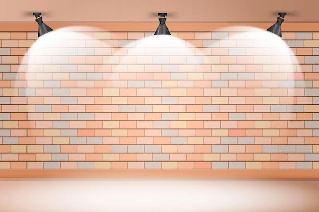 Backsteinmauer mit scheinwerferhintergrund