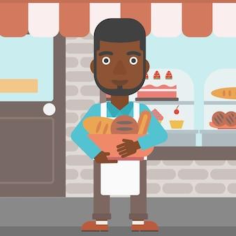 Bäcker, der korb mit bäckereiprodukten hält.