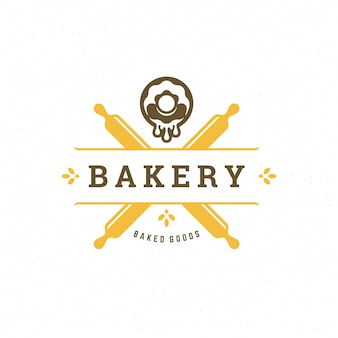 Bäckerei-logo mit nudelhölzern und donut-silhouetten