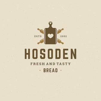 Bäckerei-logo oder abzeichen vintage vektor-illustration nudelholz silhouette für bäckerei shop