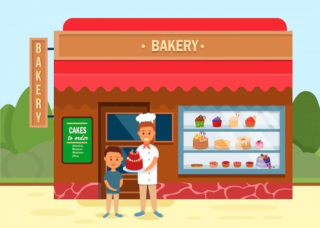 Bäckerei mit chef, der der jungenfahne den kuchen gibt.