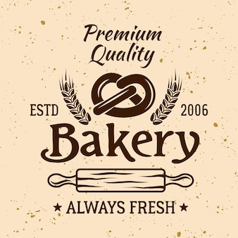 Bäckerei-vintage-vektor-emblem, etikett, abzeichen oder logo mit brezel und nudelholz auf hellem hintergrund