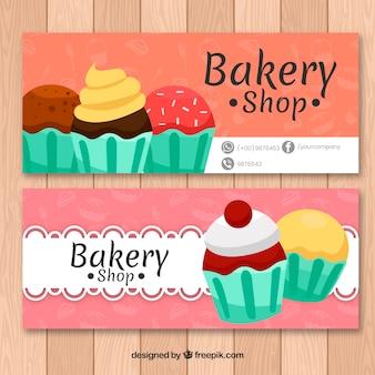Bäckereifahnen mit kleinen kuchen in der flachen art