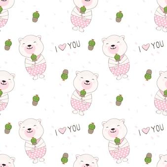 Bär, der ein nahtloses muster des kaktus halten lächelt