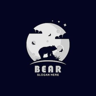 Bären-silhouette-logo auf dem moo