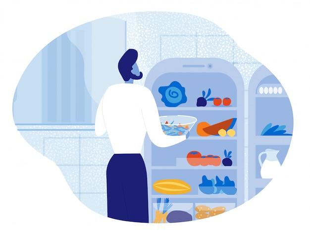 Bärtiger mann, der nahe geöffnetem kühlschrank mit essen steht