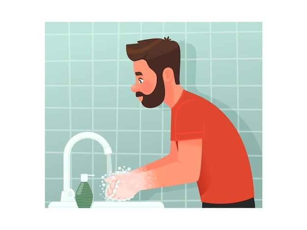 Bärtiger mann wäscht sich im badezimmer die hände mit seife einhaltung der persönlichen hygiene