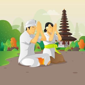 Balinesischer mann und frau, die an der stillen tagesfeier beten Premium Vektoren
