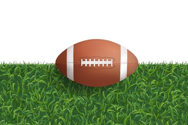 Ball des amerikanischen fußballs auf grünem gras.