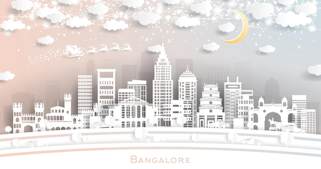Bangalore indien skyline der stadt im scherenschnitt-stil mit schneeflocken, mond und neongirlande