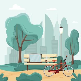 Bank mit laptop, kaffee und fahrrad im stadtpark; freiberuflicher oder studentischer arbeitsplatz
