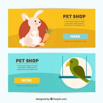 Banner für ein haustier-shop mit einem kaninchen und einem vogel