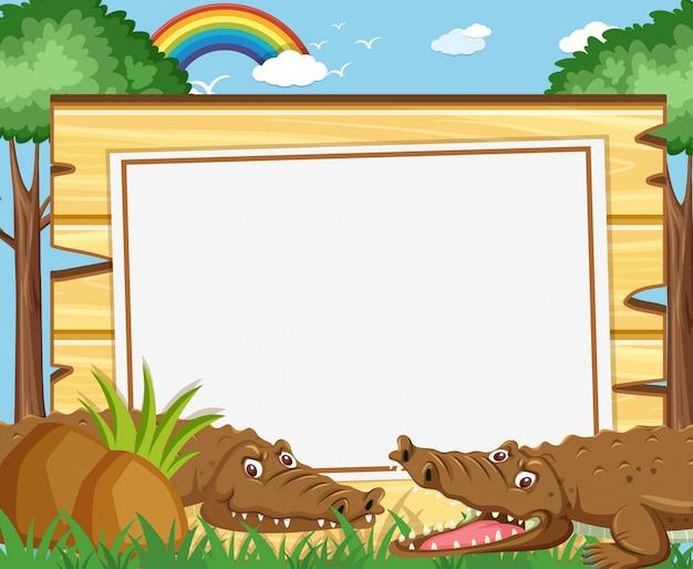 Bannerschablone mit braunen krokodilen im park