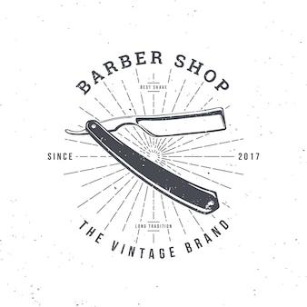 Barber shop-logo mit razor, vintage-abzeichen
