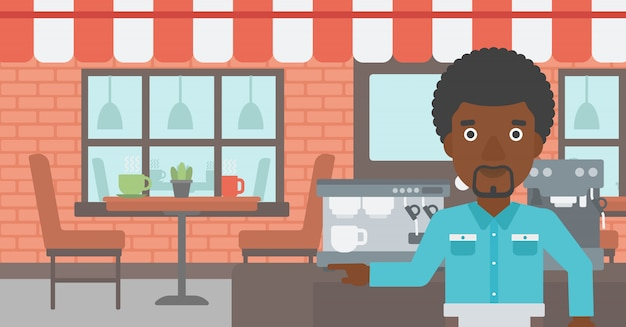 Barista, der nahe kaffeemaschine steht.