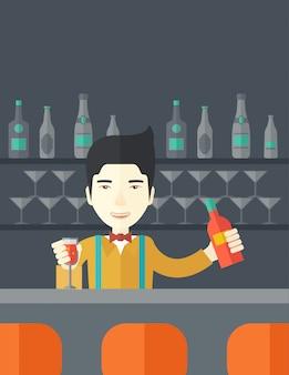 Barkeeper an der bar hält einen drink