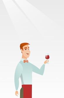 Barmixer, der in der hand ein glas wein hält.