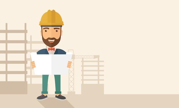 Bauarbeiter, der den plan hält.