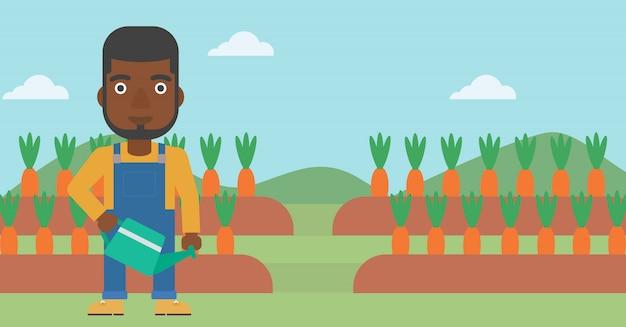 Bauer mit gießkanne
