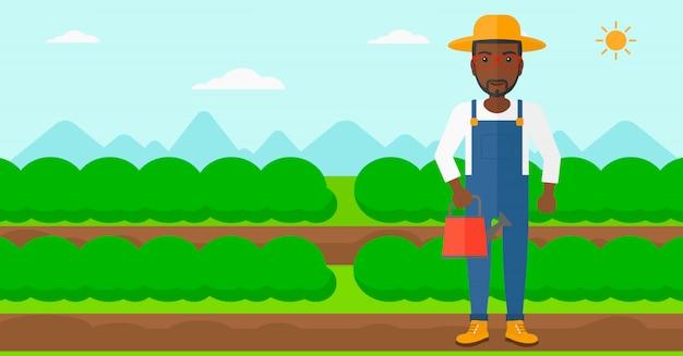 Bauer mit gießkanne.