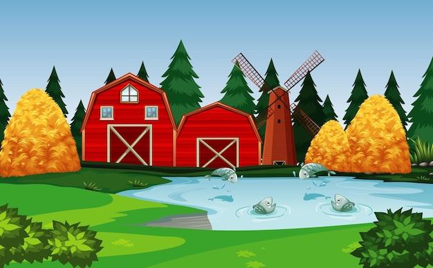 Bauernhof mit roter scheune und windmühlenszene