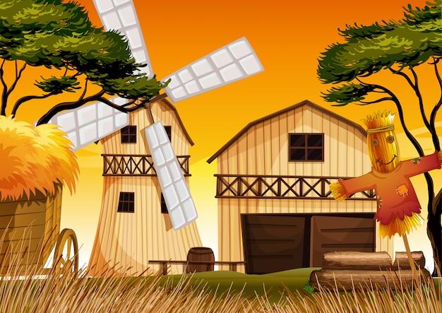 Bauernhofszene in der natur mit scheune und windmühle und vogelscheuche