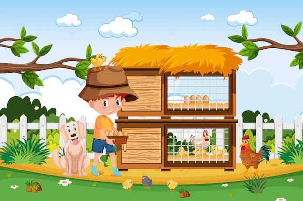 Bauernhofszene mit bauernjunge und hühnern auf dem bauernhof