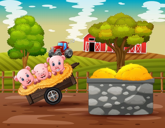 Bauernhofszene mit drei kleinen schweinen auf dem wagen