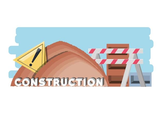 Bauzone mit sandhaufen und warnbarriere