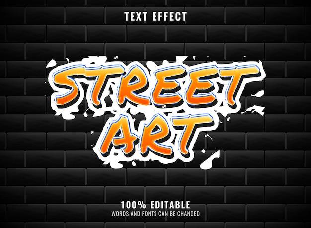 Bearbeitbarer graffiti-texteffekt der orangefarbenen straßenkunst