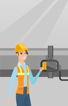 Bediener, der detektor auf erdgasleitung überprüft.