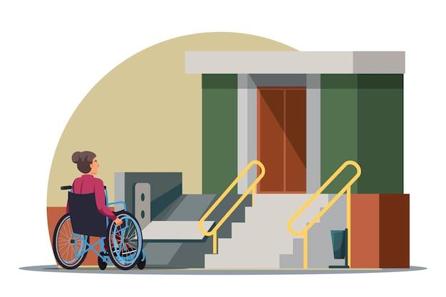 Behinderte frau im rollstuhl, zugangsrampe im eingang des mehrstöckigen hauses