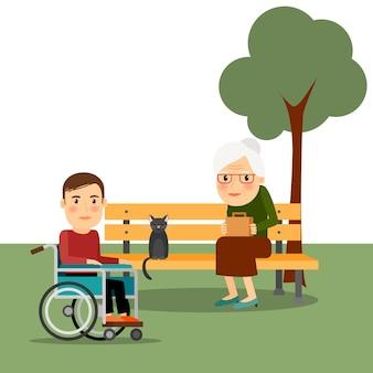 Behinderter mann auf rollstuhl im park