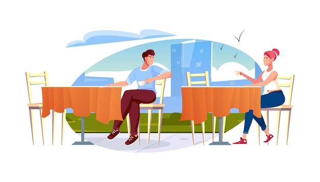Bekannte romantische komposition mit stadtbildhintergrund und mann, der dem mädchen neben dem tisch zwinkert