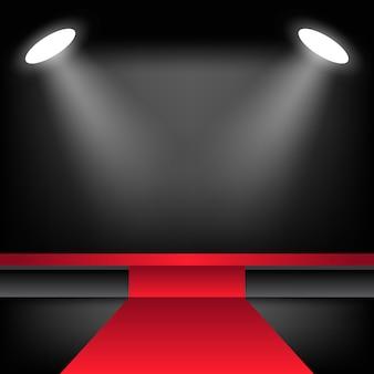 Beleuchtete bühne mit rotem teppich