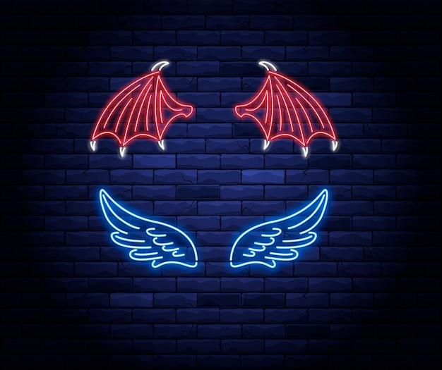 Beleuchtete neonrote teufel und blaue engelsflügelzeichen