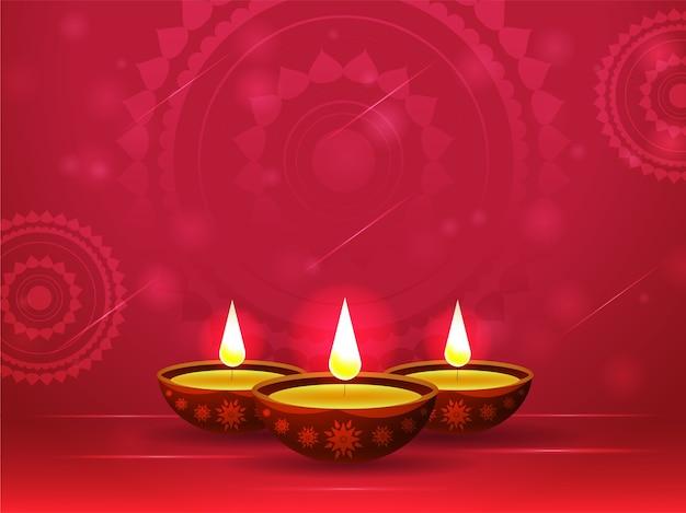 Beleuchtete öllampen (diya) auf rotem mandala-muster-hintergrund.