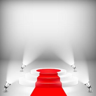 Beleuchtetes podium mit rotem teppich